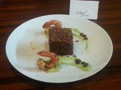 riso venere con uvetta passa con gamberi rossi Argentini con purea di piselli