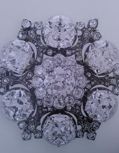 Seen on Queen Elizabeth at the opening ceremony of the London 2012 Olympic Games: Queen Adelaide's old-cut diamond brooch