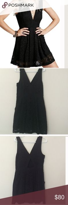 Black lace free people dress Size small black lace dress by Free People. Side hidden zipper. Has pockets! Vneck snd cut out detail on back Free People Dresses