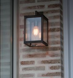 Wall light with Edison Squirrel bulb and Lanes Ceramic Works klompie bricks cladding the wall