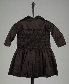 Smocked Black Silk Toddler's Dress, circa 1845 | Possibly mourning, though not confirmed by the museum. #1840s #Victorian