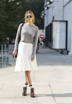 Pair a light cropped sweater with a knee-length skirt, socks, and booties