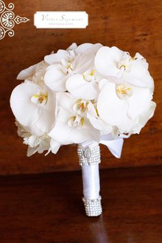Small bouquet of orchid blooms for bridesmaid