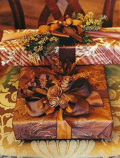Christmas present wrapped in brown marbleized paper, decorated with a brown satin ribbon and pinecones -- Carolyne Roehm -- photo by Stefan Studer -- House Beautiful, 2001