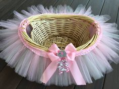 This basket is fully customizable in any variety or combination of colors, ribbon, flowers, etc... Matching tutu, tutu dress, and headbands coming soon but available now through a custom order. This is a pink and grey elephant themed tutu basket. The measurements are approximately 16x7x12 Perfect size for birthday gifts, baby shower gifts, favors or goody bag holder, Easter gifts, to hold cards, raffle items, or a nursery décor accessory. The quality medium wicker basket is adorned with 100…
