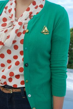 Oh my god! White and red polka tie neck blouse, teal cardigan and boat brooch. Love.