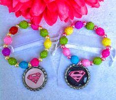 Un favorito personal de mi tienda Etsy https://www.etsy.com/es/listing/472554749/10-pcs-supergirl-pulseras-rosas