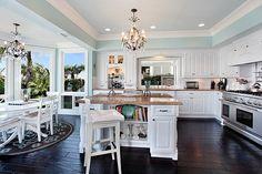 Dark floor and white kitchen... YES!