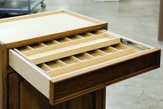 Two Tier Cutlery Drawer! I love this idea for putting the knives under so the kids don't get to them!