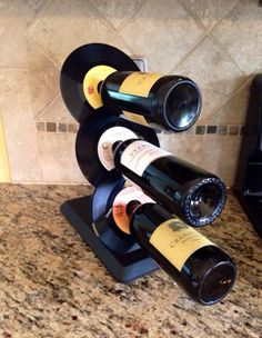 """Repurposed vinyl turned into a wine rack. For more items made with records check out the Musicasartbysarah shop section """"Record Store Re-spun"""" at:https://www.etsy.com/shop/MusicAsArtBySarah?section_id=13646235&ref=shopsection_leftnav_1"""