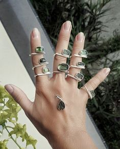 This single moldavite sits majestically atop a carefully hand-shaped sterling silver ring. Its raw beauty and imposing power seem drawn from the depths of the earth itself. Unrefined yet elegant at the same time. The adjustable ring is carefully hand-shaped from 925/1000 sterling silver and is made to last a lifetime.  Each piece is handmade and each gemstone is unique by its size, shape and color, so each ring is one of a kind. Bagan, Argent Sterling, Sterling Silver Rings, Meteorite Ring, Green Gemstones, Hand Shapes, Displaying Collections, Silver Bars, Precious Metals