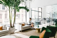 "And nothing says ""Homepolish"" like a floor-to-ceiling palm tree paired with modern West Elm furnishings."