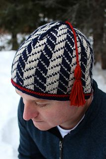 Lars is a DK weight hat in a cool, yet classic, design suitable for both men and women. The two-color Fair Isle pattern is maintained through crown decreasing to finish.