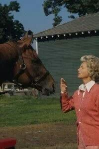 Secretariat and his owner, Penny Chenery (you know that part in the movie...where Penny asks to have a moment with Red and it's like they just look right into each other's hearts and completely understand...I cry)