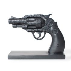 """Book End - Duello Gun    Thoughts of gun slinging cowboys fill one's mind when the term the """"Wild West"""" is uttered. Inspired by these quick draw duels made famous by the spaghetti westerns of the silver screen, the Duello Series features a Belly Gun Bookend and a Revolver Jewelry Holder. This dueling duo is the perfect accessory to any study or saloon.   $49.95"""