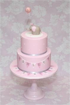 This cake is based on my original Baby Elephant Cake but in Pink, White and Grey colours, for a little girl's Birthday. The Baby Elephant figurine is made to match the cute Invitations and Party Printables designed by Sarah from. Elephant Baby Shower Cake, Elephant Cakes, Baby Shower Cakes, Elephant Balloon, Elephant Theme, Grey Elephant, Pink First Birthday, Baby Birthday Cakes, Elephant Birthday Cakes