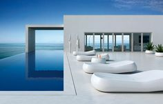 Love the elongated pool and the windows! x