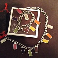 Coach Matching Chain and Bracelet with Multi-colored Charms....  Very Nice Set, with matching Coach pouch and gift box...