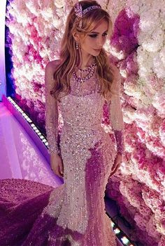 Sargis Karapetyan, 23—the son of Armenian billionaire Amvel Karapetyan, who sits at number 28 on the Forbes Russian Rich List—married his bride Salome Kintsurashvili, 25, in a lavish $2 billion wedding.  Here is the bride in one of her many outfit changes, dancing to Maroon 5.  The bride wore three different couture dresses by Elie Saab and Alessandra Rich, and jewelry worth $200,000, and that was just the start. Her accessories included a Tiffany Savoy headpiece, made of diamonds and…