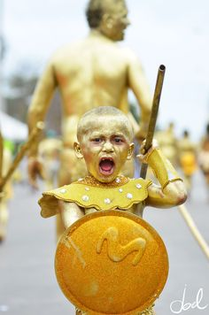 Child taking part in the Flower Parade at Barranquilla Carnival, Colombia. (Photo: Joel Duncan)