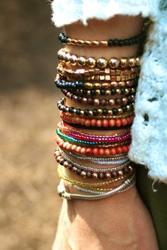 Stacks of colorful beaded bracelets. Not childish or  #overthelimit. With a reasonable combo just beautiful.