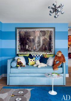 In Sir Elton John and David Furnish's Beverly Hills residence, interior designer Martyn Lawrence Bullard used a marble-top Saarinen table in their son Zachary's blue-striped room. Benjamin Moore, Nursery Inspiration, Design Inspiration, Nursery Ideas, Kids Bedroom Sets, Kids Rooms, Bedroom Ideas, Childrens Bedroom, Guest Bedrooms