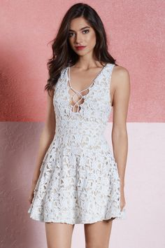 Be a sweetheart with the Darling Lace Up Skater Dress.  Featuring a front lace up detail and lace fabrication.  Pair with pointed heels and statement jewelry.