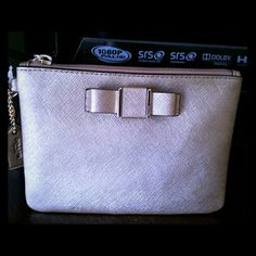 """COACH GOLD DARCY BOW SMALL WRISTLET NWT Small Gold color bow small Darcy wristlet. Made of saffiano leather. Measurs approx. 6""""x 4 1/2"""" x .5"""". and has a zip Closure. Fabric Lining. Silver Tone Hardware.  Totally adorable. 2 available. Coach Bags Clutches & Wristlets"""