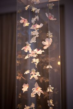 Floating Orchids inside Lucite Chuppah  Floral & Decor: Bold American Events
