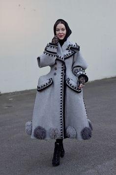 Ulyana in a vintage folk style coat . Adore!