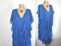 Cute and flowy boho dress from the 1970's.  Features: -Flowy semi sheer layers -Pull over style, no zipper -Fully lined -Label: Lori Masc, New