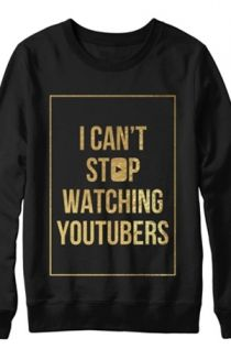A 'I CAN'T STOP WATCHING YOUTUBERS' Long Sleeved Jumper. Black And Gold Coloured, By Tyler Oakley.