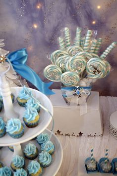 Cupcakes and lollipops at a Frozen Birthday Party!  See more party ideas at CatchMyParty.com!
