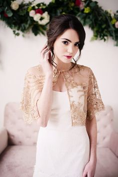 Our gorgeous golden beaded capelet is made with deep gold lace and hand detailed beading with a scalloped edge. This golden capelet has a hook and loop closure for a seamless look, french seams and fits most sizes. Please allow slight lace placement variations since these are handmade.  -Available in white, ivory and gold  -Photography by Deyla Huss Photography