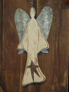 Primitive Wooden Angel with rusty tin wings. Use her indoors or out. Rustic and folk Art descibe her perfectly. by FurnitureByTodd on Etsy