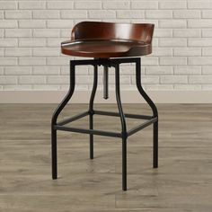 The adjustable stool features a contoured wood top with an adjustable metal base. This multi functional piece complements both traditional and modern decor. Instead of a conventional chair, pull up this stool to a desk or use as additional seating at a dining table.