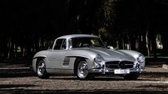 The Mercedes-Benz 300SL Gullwing was one of the automotive sensations of the 1950s and today remains one of the most iconic cars of the entire 20th century. Description from roadtrippers.com. I searched for this on bing.com/images