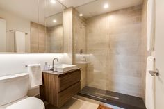 Common Living // Common Baltic // Bathroom | Mirrors // Wood Accents // Glass Doors