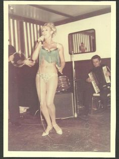 A rare shot of Our Sandra partaking in an early karaoke night - that girl always had stars in her eyes !