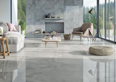 Full of sunlight, a light-grey living room opens to the nature thanks to its large window glazing. Bright ceramic tiles with a glossy surface on the wall ...
