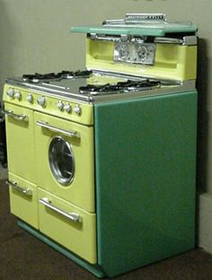 Western Holly Vintage Custom Color Yellow & Green antique stove. This almost looks like they built a Frankenstein appliance. 2 tone part stove part washer/dryer (it's that funky round window). Kind of a key lime color scheme. I like it. Now you just need a matching fridge.