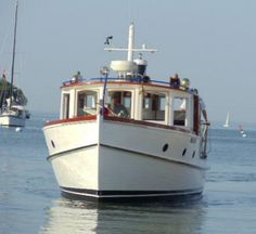 "Put-in-Bay, from Miller Marina. A cruise aboard the vintage ""Restless"" ideal for on board wedding photos, honeymoon, sunset and shoreline cruises. Lake Erie"