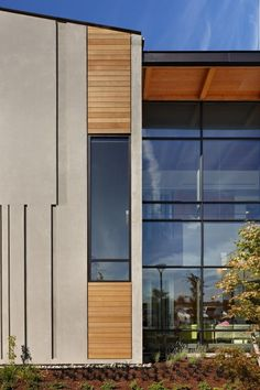 Everett ClinicThe exterior turns tilt-up concrete into an architectural statement by incorporating wood and metal accents, storefront windows, and vertical cast into the building skin
