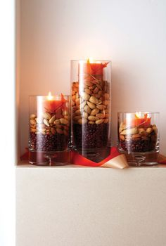 Buy numerous pillar candle lights in one solid color and place each on silk fall leaves. Group your candles in various heights and place a few nuts or small gourds at the base of the candle lights for a unique fall appearance. Thanksgiving Crafts, Thanksgiving Table, Thanksgiving Decorations, Fall Crafts, Seasonal Decor, Decor Crafts, Holiday Crafts, Holiday Fun, Fall Decorations