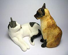 several clay cats photos