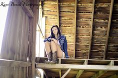 2014 High School Senior girl for posing picture ideas. Old barn in a hay loft...vintage look. Modeling in an old barn with cowboy boots and shorts.