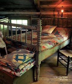 Primitive bed and beautiful quilts. Perfect for a prim room.
