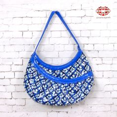 """VERA BRADLEY HOTSY TOTSY HOBO BLUE.NWOT New without tags hotsy totsy hobo blue lagoon print from frill collection. Easy to clean material, large front pocket with scallop trimming. Inside features 2 slip pockets and one zipper closure. 15"""" x 8"""" x 3"""". Drop 11"""". Vera Bradley Bags Hobos"""