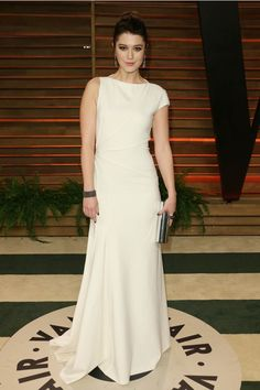The Oscars 2014  Smashed actress Mary Elizabeth Winstead toughens up her simple cream gown with black accessories and smoky eyes.