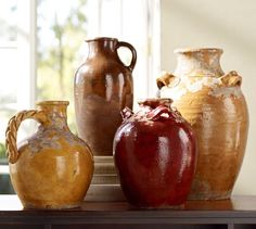Sicily Vases | Pottery Barn are a touch of patina.  place a sculptural branch in these for an instant display